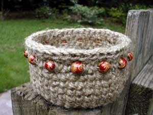 jute basket with maroon wooden beads