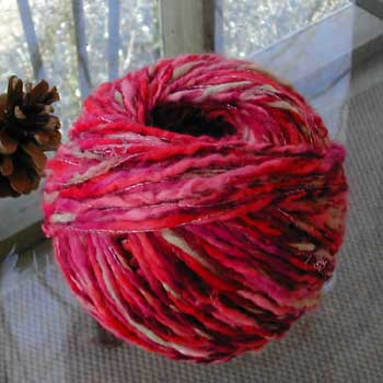 My first ball of yarn from the sweater, washed, dried, and wound into a